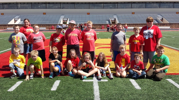 Mrs Denham's 3rd Grade Class takes a Class Photo at Friday's Paint The Town Red celebration at Pittsburg State.