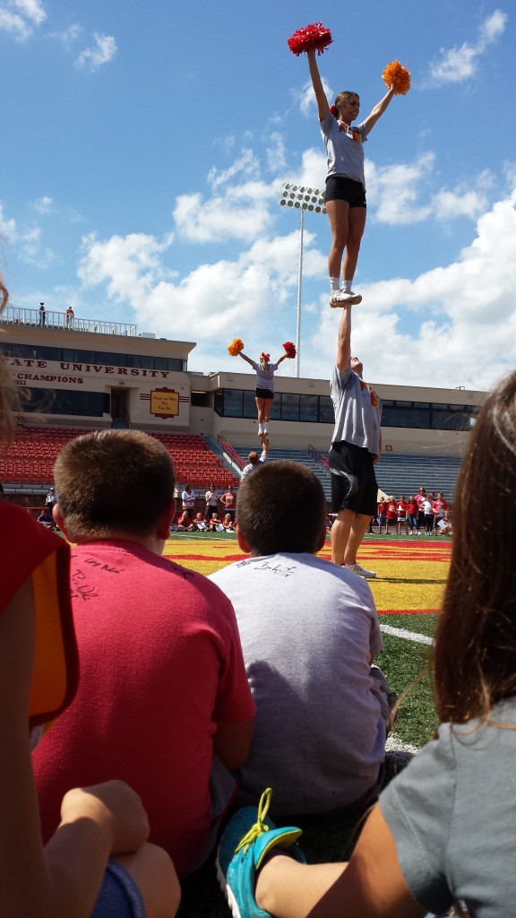 Mrs Denham and Mrs Fox's 3rd Grade Classes watch the Spirit Squad perform at Friday's Paint The Town Red celebration at Pittsburg State.