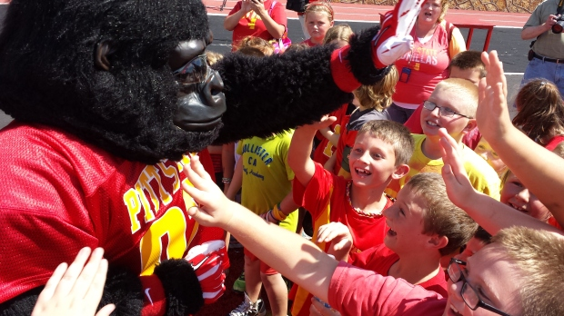 Mrs Denham and Mrs Fox's 3rd Grade classes with Gus The Gorilla at Friday's Paint The Town Red celebration at Pittsburg State.