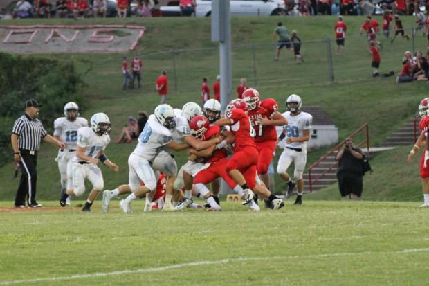 The Southeast Lancer defense continuously swarmed the Baxter Springs offense in Friday's 36 to 0 victory.  Due to a 90 minute lightning delay in the first quarter Friday's game didn't finish until about 10:30 p.m.