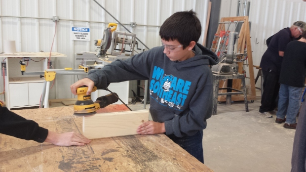 Southeast eighth grade student Trenton Hartman of McCune sandblasts a door plaque he is making at the 6th Annual Careers in Construction Week.  The event is at the Fort Scott Community College satellite campus in Pittsburg.
