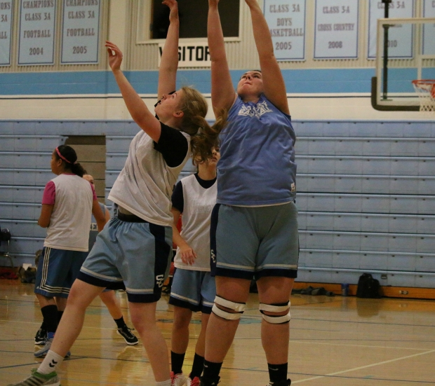 Southeast junior Katharina Jens and senior Maggie Renn reach for a rebound at this week's Blue-White Scrimmage.  On Friday, Southeast hosts Oswego.  The Varsity Girls play in the East Gym at 6 p.m.  The Varsity Boys game follows.