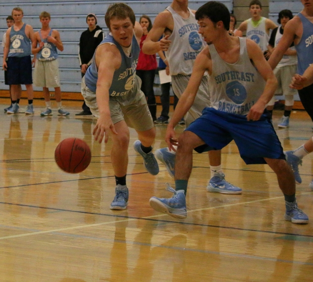 "Southeast seniors Riley Ulery and James Zimmerman fight for a loose ball at this week's Blue-White Scrimmage.  The Southeast Boys slogan this year is ""Dirty Tough"" and the team's coach says it's a reminder to do all of the little things it takes to win."