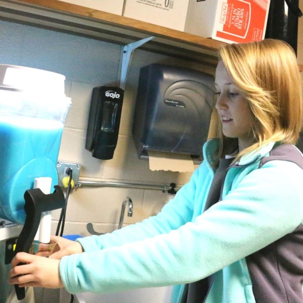 Southeast senior Katie Yancey prepares a blue raspberry fruit slush at the Southeast High School Spirit Shack. The store is student operated and generates funds for clubs and organizations at the school as well as scholarships for Spirit Shack employees.