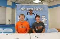 Riley Ulery and Caleb Biancarelli with Southeast Coach David Dainty