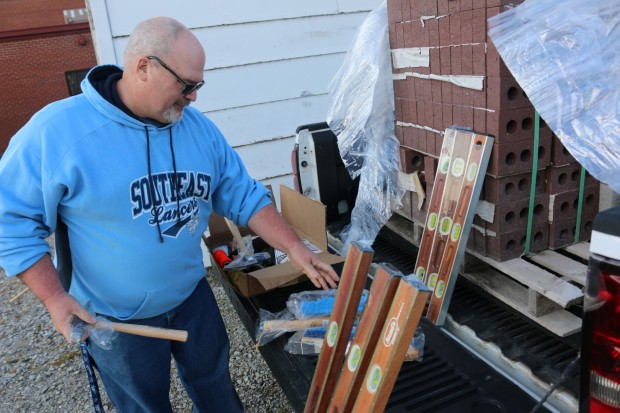 Southeast SkillsUSA chapter sponsor Jim Rockers sorts through tools and supplies donated to the student organization by Joplin Building Material Company and Kraft Tools Company.