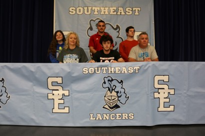 Southeast senior Tyler Kester is pictured with his parents, Dennis & Stacy Kester, his brother and sister, Levi and Maddy, and Labette Community College Wrestling Head Coach Jeff Vesta.