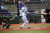 Cole Burdette hits a double at Game 1 of State