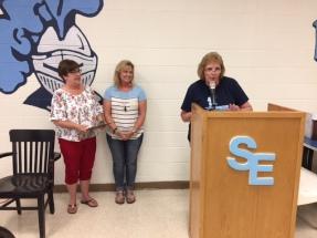 Tammie Hall and Cara Kubler speak on behalf of Linda Solomon